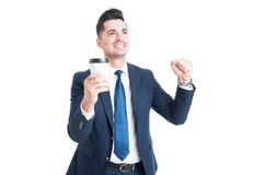 Successful young businessman enjoying success on coffee break Royalty Free Stock Images
