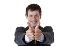 Successful young businessman holds both thumbs up Stock Photos