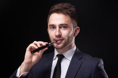 Successful Young Businessman In A Stylish Business Suit On A Bla Stock Photography