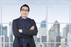 Successful young businessman near the window Royalty Free Stock Photo