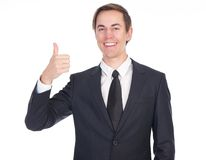 Successful young businessman showing thumbs up Royalty Free Stock Images