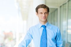 Successful young businessman smiling Royalty Free Stock Image