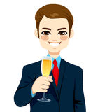 Successful Young Businessman Toasting Champagne Stock Photo