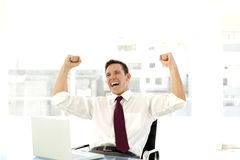 Successful young businessman at workplace Stock Photography