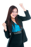 Successful Young Businesswoman Cheering. Portrait of happy young businesswoman cheering with clenched fists, isolated on white Stock Photography