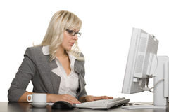 Successful young businesswoman with computer Royalty Free Stock Images