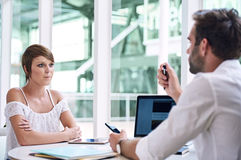 Successful young businesswoman getting financial advise from business consultant Royalty Free Stock Photos