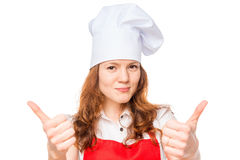 Successful young chef shows thumb up Royalty Free Stock Photos