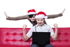 Successful young christmas couple Royalty Free Stock Images