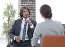 A relaxed conversation of a man and a woman in the office. Successful young consultants working as business team in an office analyzing documents Royalty Free Stock Photo