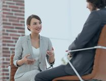 A relaxed conversation of a man and a woman in the office Stock Photo