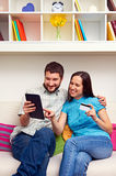 Successful couple making purchases on the internet Stock Photos