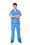 Successful young doctor. Portrait of successful young doctor in blue uniform. isolated on white background royalty free stock image