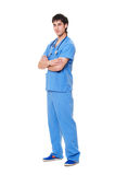 Successful young doctor in blue uniform Royalty Free Stock Image