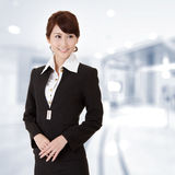 Successful young executive woman. Smiling, closeup portrait in office Royalty Free Stock Images