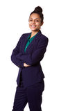 Successful young female business executive standing relaxed Royalty Free Stock Photo