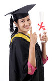 Successful young female graduate Stock Photo