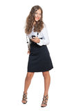 Successful young girl. Young girl in business outfit with mobile phone Stock Photography