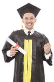 Successful of young graduation man smiling while holding diploma Royalty Free Stock Images