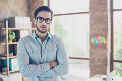 Successful young handsome middle eastern man lawyer in a formal. Outfit and glasses with crossed hands. Severe and harsh, rich and confident, attractive and royalty free stock photo