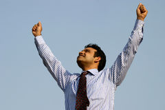 Successful young indian business  man. Young successful business man expressing Stock Photo