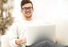 Successful young male freelancer working on laptop at home. Photo with copy space Stock Photography
