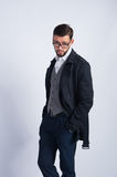 Successful young man in a black coat Royalty Free Stock Photo