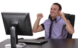 Successful Young Man. Happy young businessman in fornt of his computer, isolated against a white background Stock Images