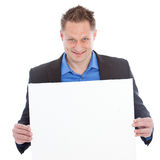 Successful young man holding a blank whiteboard Royalty Free Stock Image