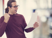 Successful young man holding paper Stock Image
