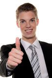 Successful young man holds up thumb Stock Photos