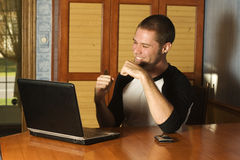 Successful young man on laptop. Working from home Royalty Free Stock Photos