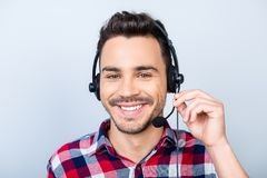 Successful young man operator of a online hot line customer representative is smiling, wearing a headset. He is isolated on royalty free stock photos