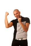 Successful young man rise arms as a sign of success isolated ove Royalty Free Stock Photos