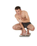 Successful young man on scale Royalty Free Stock Photo