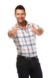 Successful young man with thumbs up Stock Images
