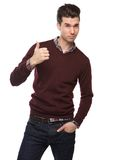 Successful young man with thumbs up hand sign. Portrait of a successful young man with thumbs up hand sign on isolated white background Royalty Free Stock Photo