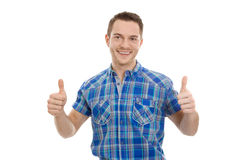 Successful young man with thumbs up. Royalty Free Stock Images