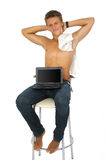 Successful young man is working on laptop. Royalty Free Stock Images