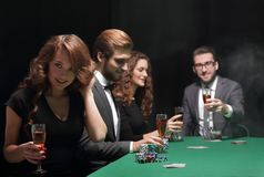 Successful young people spend the night at the casino Stock Photos