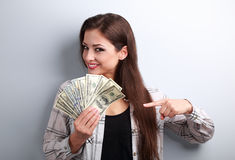 Successful young pretty woman holding dollars in hand Royalty Free Stock Image