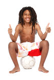 Successful young rasta teenager with thumbs up Stock Image