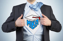 Successful young student is tearing the shirt. Business education icons are drawn on the chest. A concept of the MBA degree stock photo