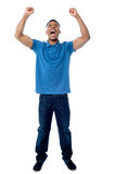 Successful young tall man. Young handsome victorious guy over white Royalty Free Stock Images