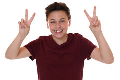 Successful young teenager boy making the victory sign Stock Images