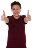 Successful young teenager boy showing thumbs up Stock Photography