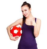 Successful young woman with ball Stock Images
