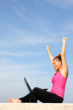 Successful young woman with her laptop stock photography