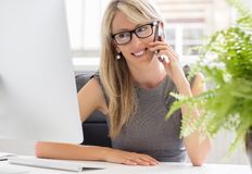 Successful young woman in her office Royalty Free Stock Photos