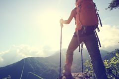 Woman hiker hiking on mountain peak. Successful young woman hiker hiking on mountain peak Royalty Free Stock Images